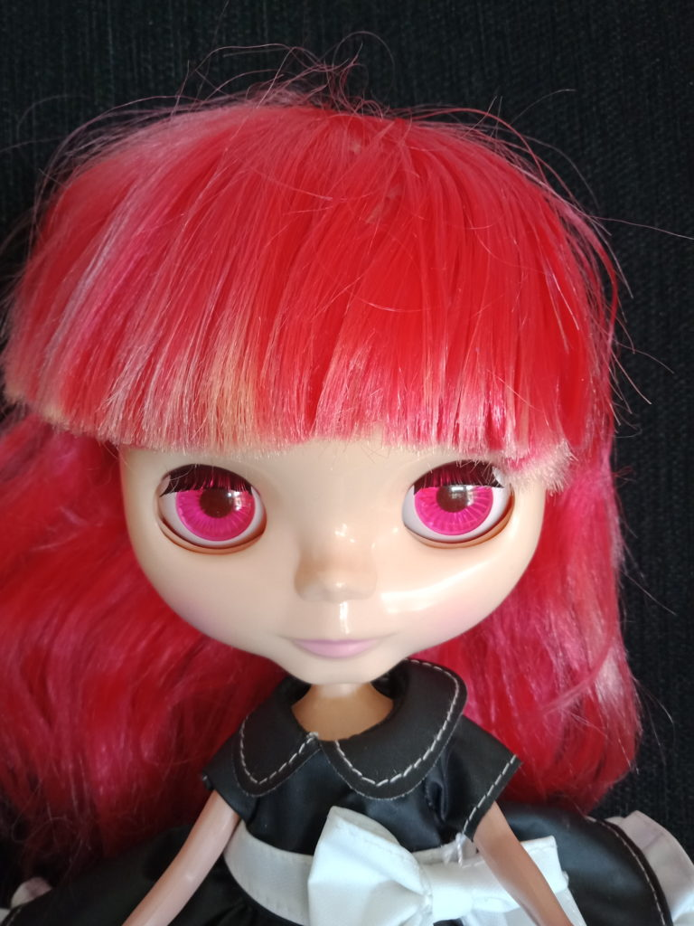 Blythe Doll with red hair change to pink eyes