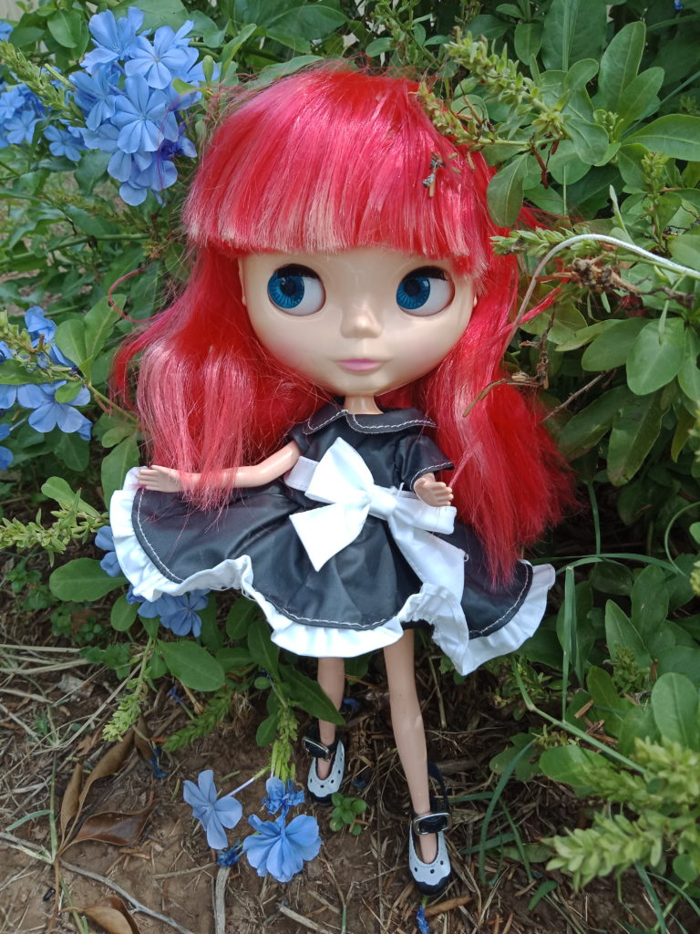 Blythe Doll with red hair and black dress
